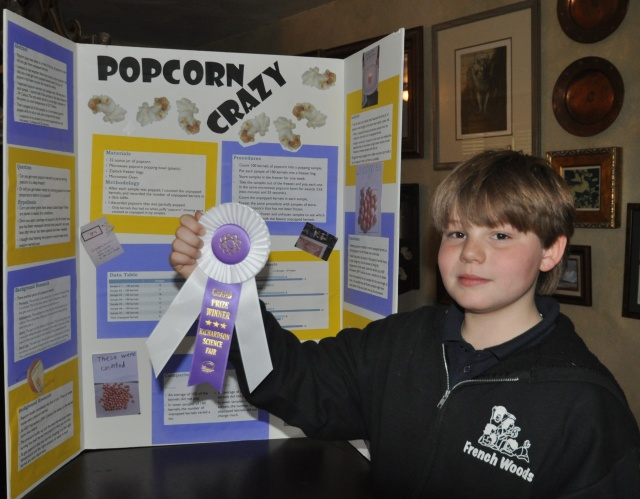 The display that helped Kameron win his school's grand prize ribbon had three data tables -- his display for regionals has five.