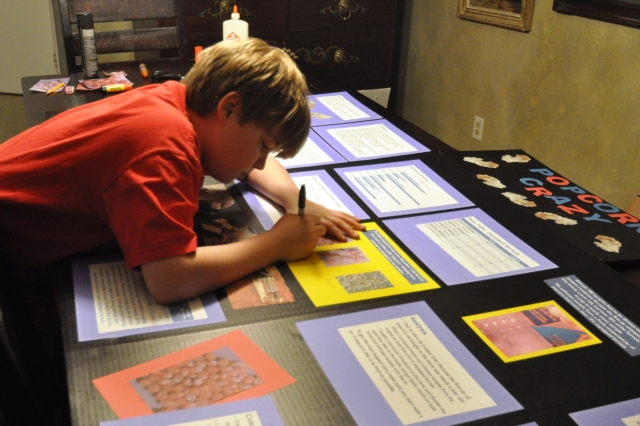 Just to be clear about who does what around here, this is the scene behind me as I post this -- Kameron is finishing his entry for the North Dallas Regional Fair. He already took the