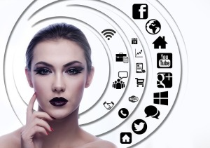 Woman's face heavily made up with social sharing icons around her by geralt from Pixabay