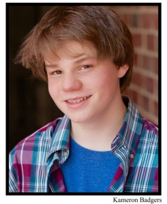 """This is a typical actor's headshot -- it has his name at the bottom, and gives a casting director a good look at his face. His resume would be affixed to the back. That's where his agent's contact information, his """"vital statistics"""" (age -- since he's a minor -- height, weight, sizes, etc.), credits, and unique skills are listed."""